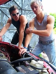 Two muscular gay guys suck dicks at the auto workshop